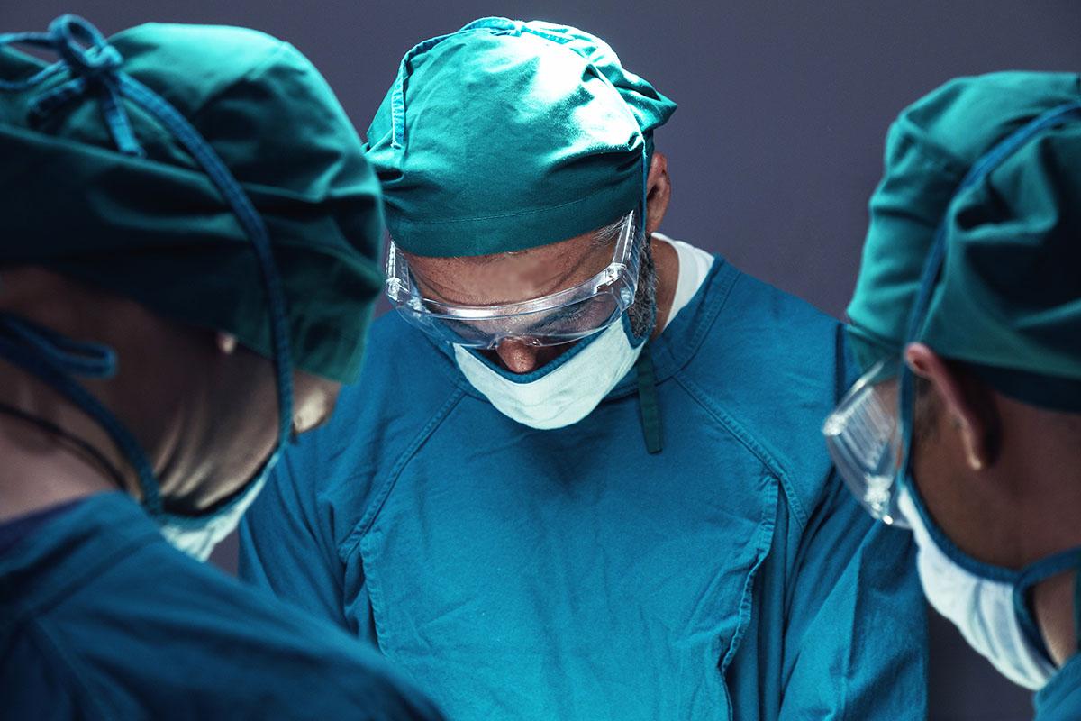 spine trauma surgeon operating on patient