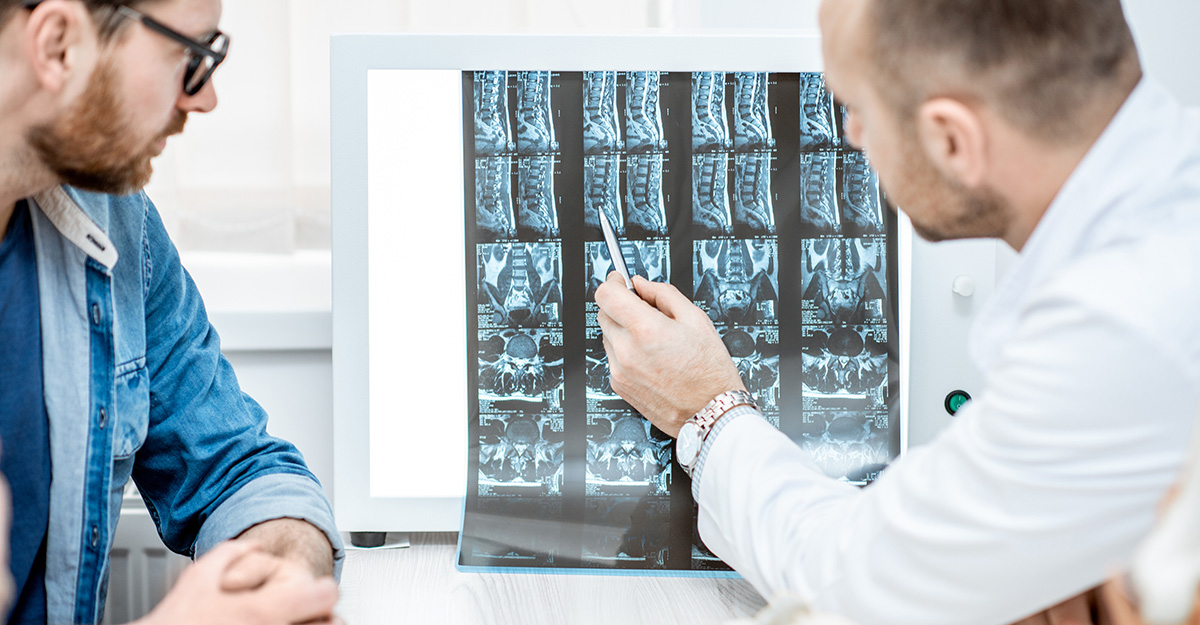 post-laminectomy syndrome patient talking with doctor