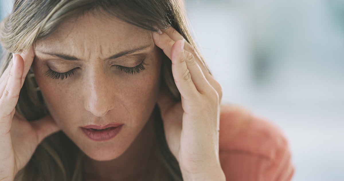 woman who suffers from headaches gets treatments