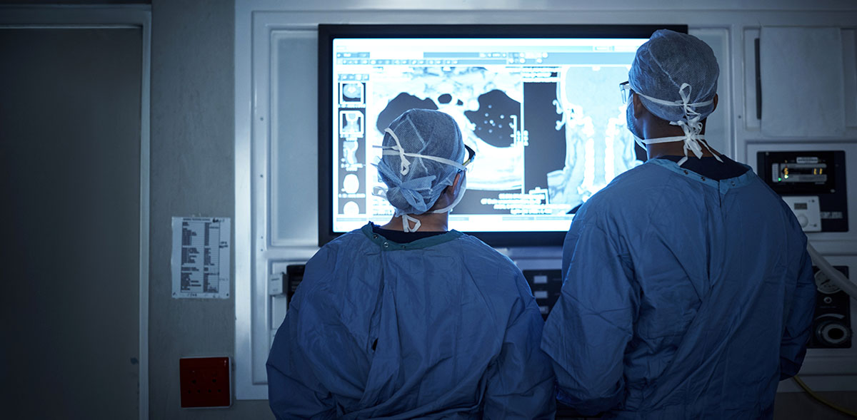 two surgeons about to perform a Posterior Cervical Decompression & Fusion