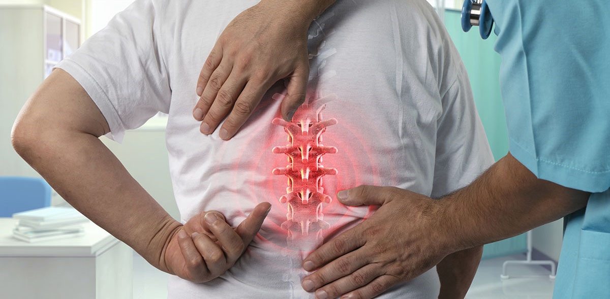 Doctor identifying spine pain