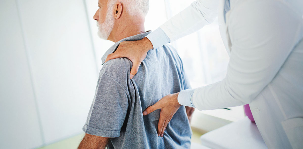doctor examine a patient with Spondylolisthesis